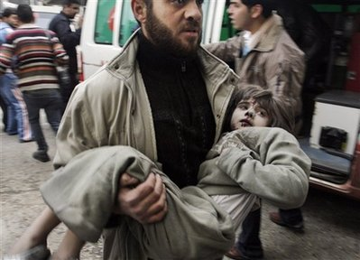 A Palestinian girl is carried, Gaza City, Saturday, Dec 27 2008.